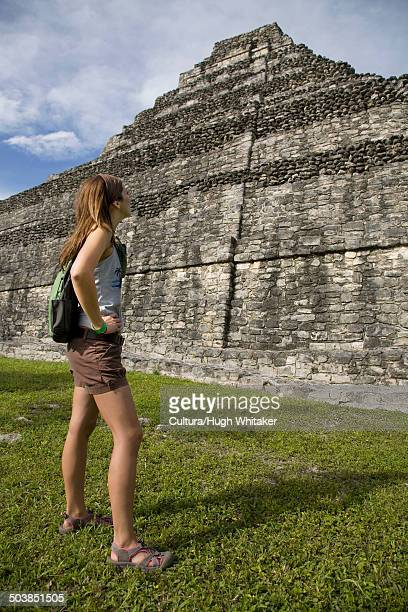 Woman Looking at Mayan Ruin