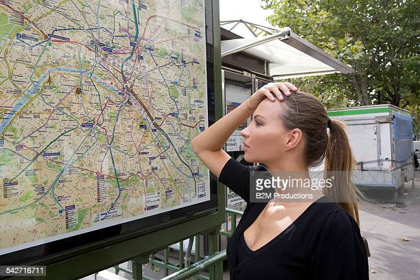 Woman looking at metro map