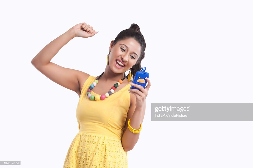 Woman looking at mobile phone and rejoicing : Stock Photo