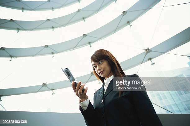 Woman looking at mobile phone, low angle view