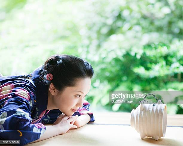 woman looking at mosquito coil - incense coils stock pictures, royalty-free photos & images