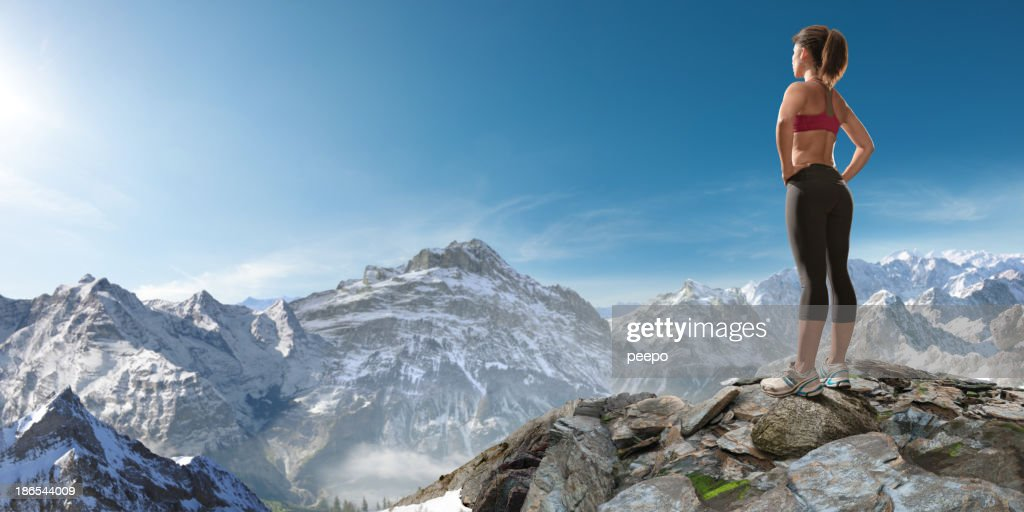 woman looking at mountains : Stock Photo