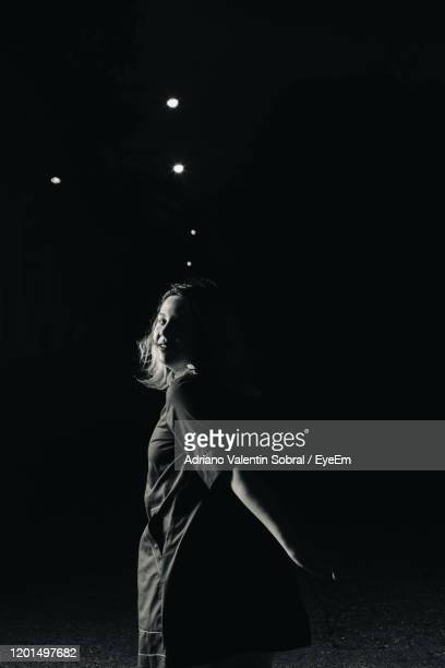 woman looking at night - sorocaba stock pictures, royalty-free photos & images
