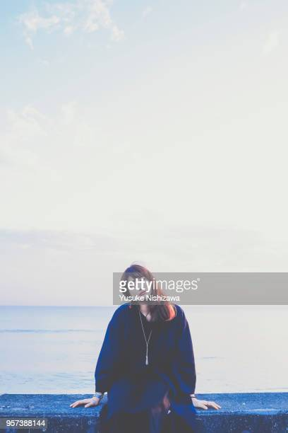a woman looking at one point - yusuke nishizawa stock pictures, royalty-free photos & images