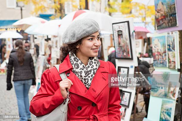 woman looking at paintings at montmartre, paris. - painting art product stock pictures, royalty-free photos & images