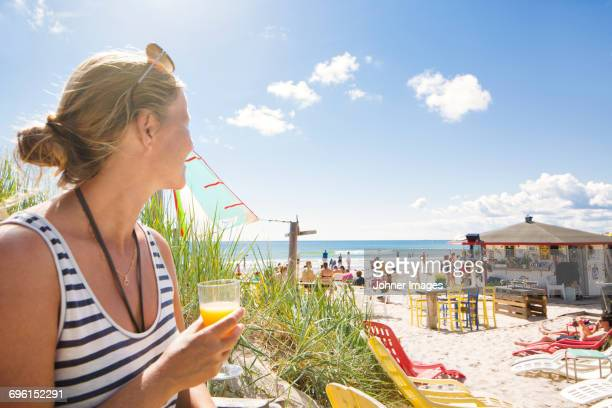 Woman looking at people on beach