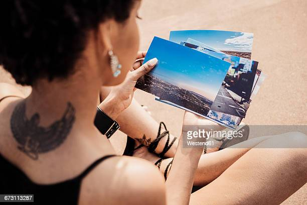 Woman looking at photographies of USA