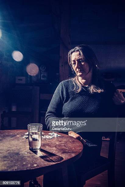 Woman Looking at Pills on the Table