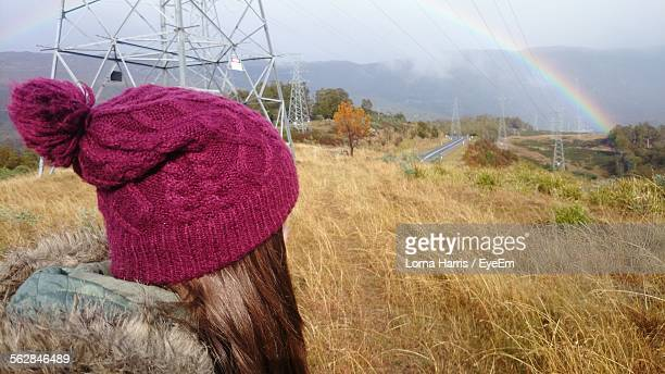 Woman Looking At Rainbow