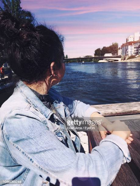 Woman Looking At River In City