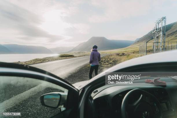 woman looking at scenic landscape in iceland near the car - purple glove stock pictures, royalty-free photos & images