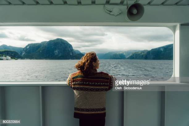 Woman looking at scenic view from ferry