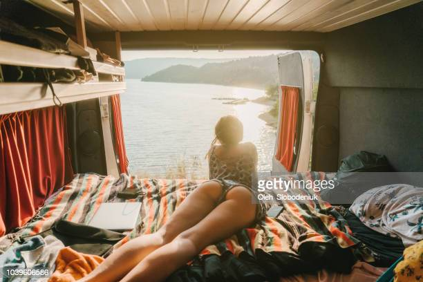 Woman looking at scenic  view of Lake of Sainte-Croix from campervan