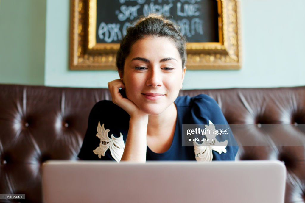 Woman looking at screen in cafe. : Stock Photo