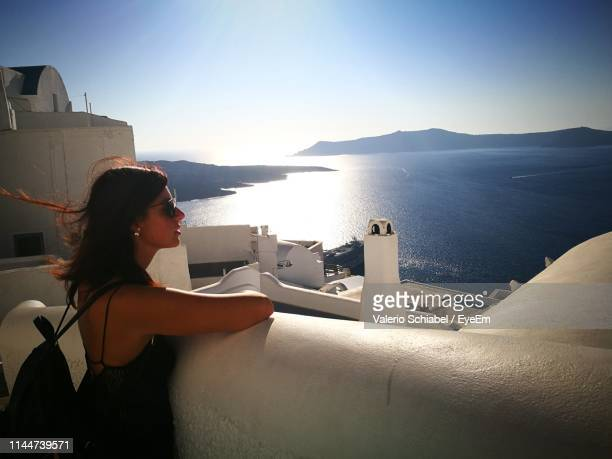 woman looking at sea against sky - tote bag stock pictures, royalty-free photos & images