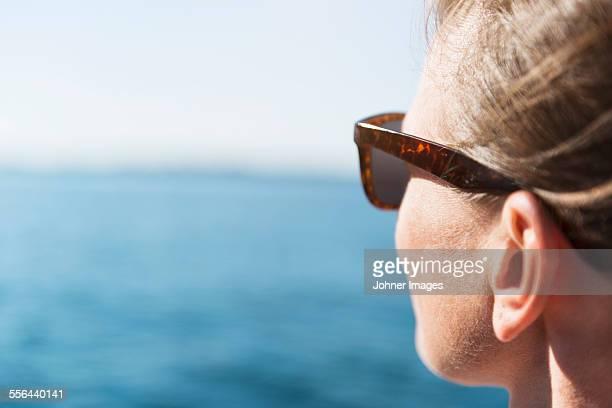 Woman looking at sea, close-up