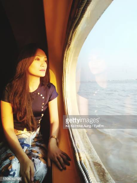 woman looking at sea - ko ko htike aung stock pictures, royalty-free photos & images