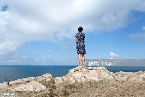 Woman looking at sea, rear view