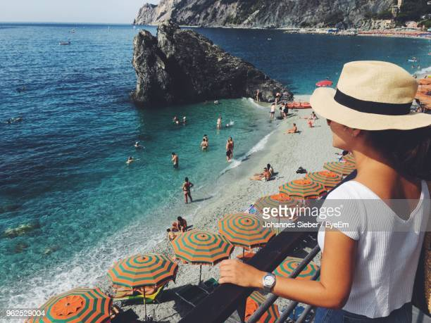 woman looking at sea while standing on balcony - cinque terre stock pictures, royalty-free photos & images