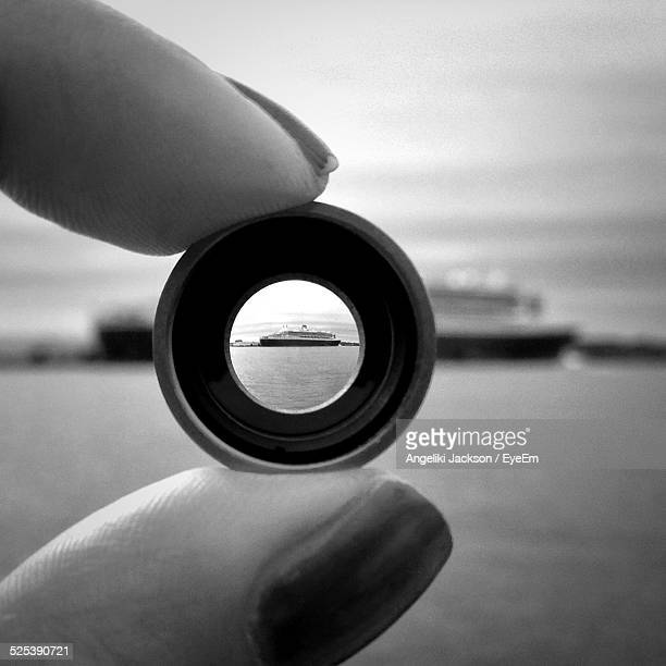Woman Looking At Ship Trough Lens