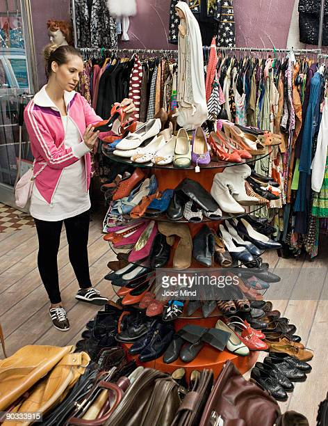 woman looking at shoes in second-hand store