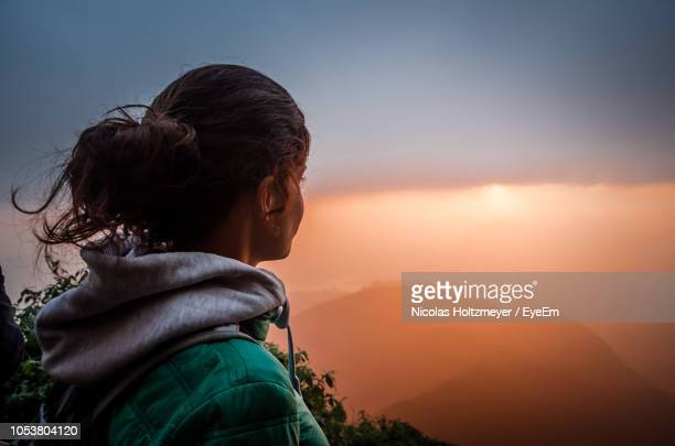 Woman Looking At Sky During Sunset