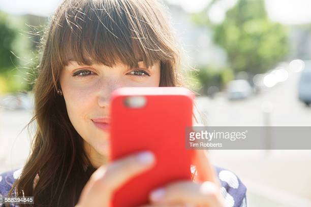 woman looking at smart phone, close up. - photographing stock pictures, royalty-free photos & images