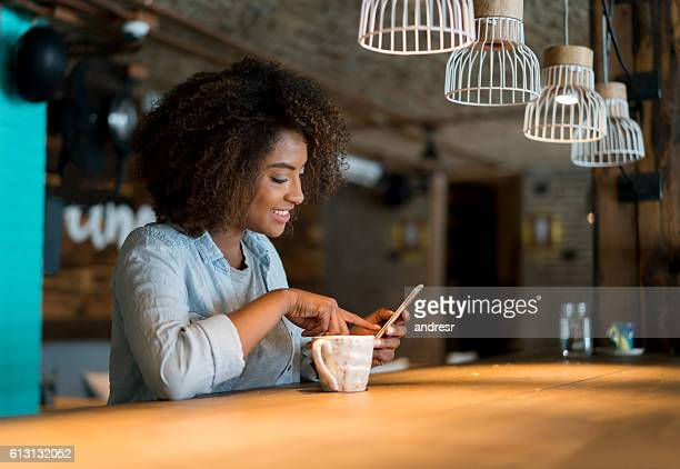 Woman looking at social media at a cafe