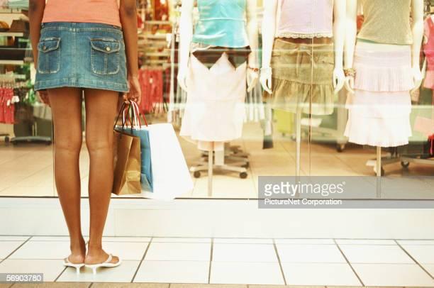 Woman looking at store window merchandise