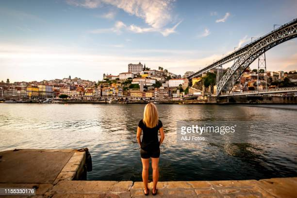 woman looking at sunset over the douro river in porto. - portugal stock pictures, royalty-free photos & images