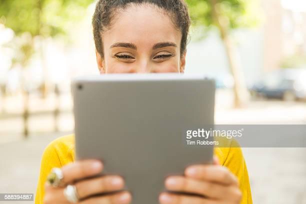 Woman looking at tablet.