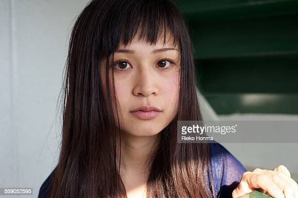 woman looking at the camera - bad bangs stock pictures, royalty-free photos & images