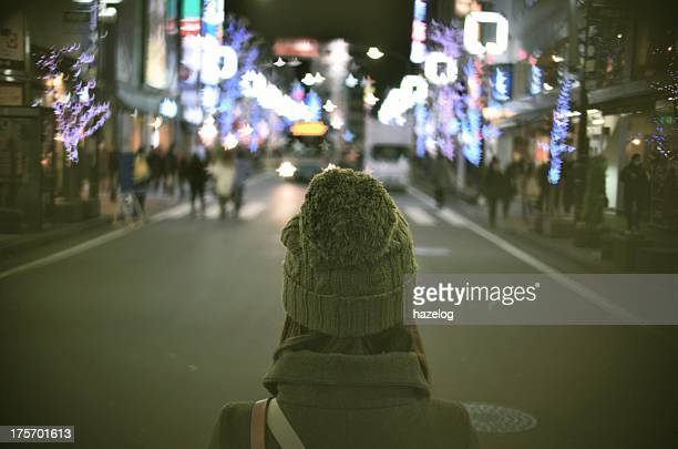 Woman looking at the city lights