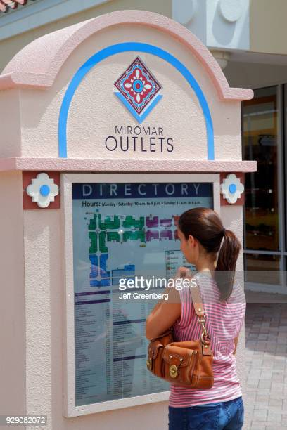 A woman looking at the directory map at Miromar Outlets