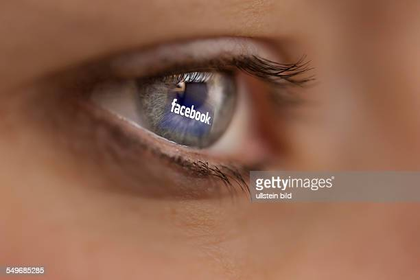 Woman looking at the internet site of the online network Facebook
