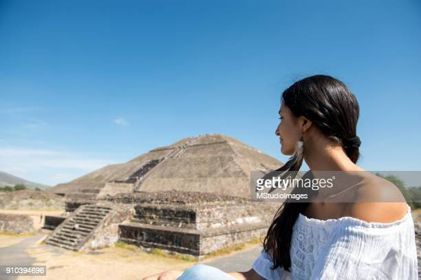 Woman looking at the Mexican pyramides.