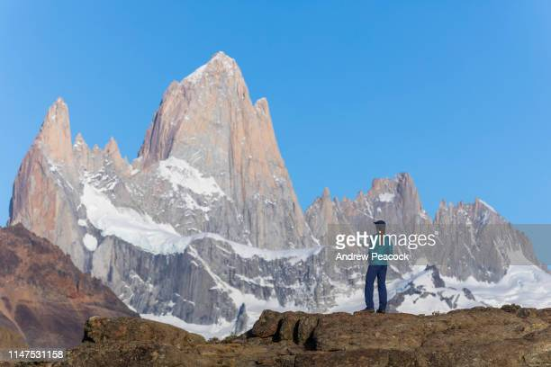 a woman looking at the monte fitz roy range - los glaciares national park stock pictures, royalty-free photos & images