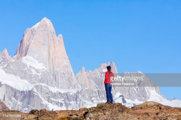 a woman looking at the monte fitz roy range - santa cruz province argentina stock pictures, royalty-free photos & images