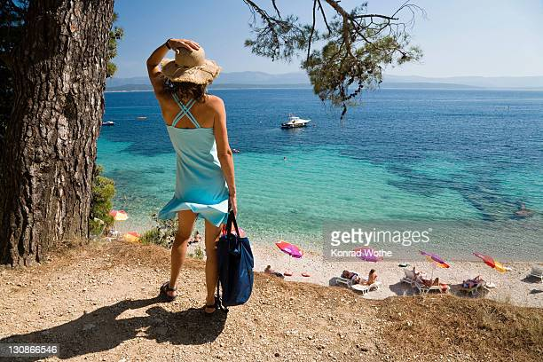 Woman looking at the sea, Bol, Brac Island, Dalmatia, Croatia, Adriatic Sea, Mediterranean, Europe