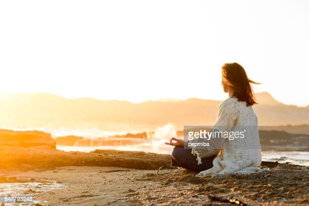Woman looking at the sea in a relaxation moment