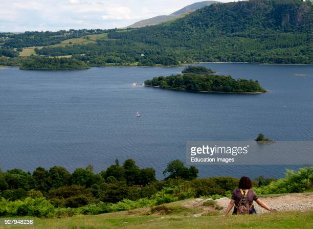 Woman looking at the view of Derwentwater The Lake District Cumbria UK