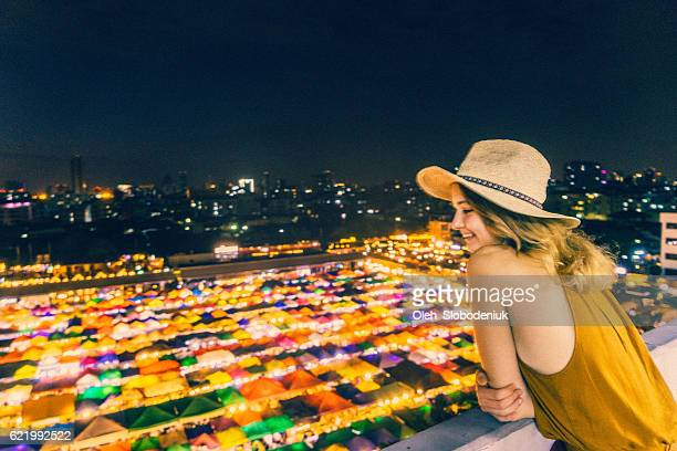 Woman looking at Train night market in Bangkok