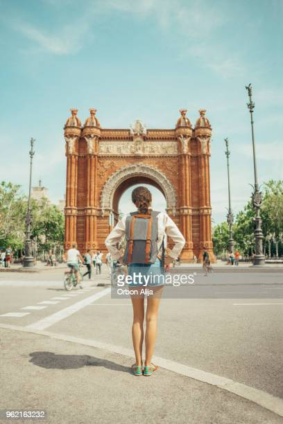 woman looking at triumphal arch in barcelona - barcelona spain stock pictures, royalty-free photos & images
