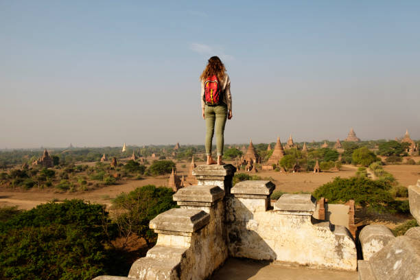 Woman looking at view, Bagan Archaeological Zone, Buddhist temples, Mandalay, Myanmar