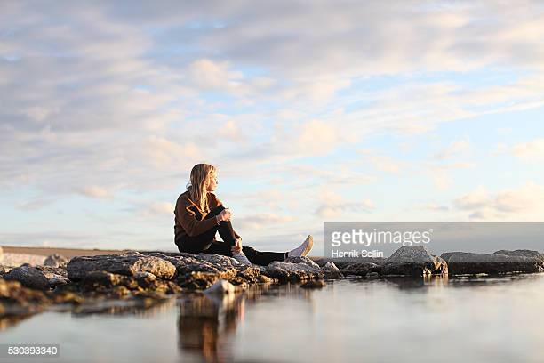 Woman looking at view, Faro, Gotland, Sweden