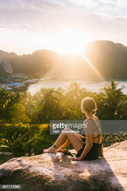 Woman looking at view of Koh Phi Phi at sunset