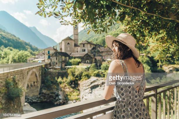 Woman looking at view of Lavertezzo village