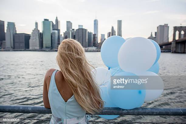 Woman looking at view of New York