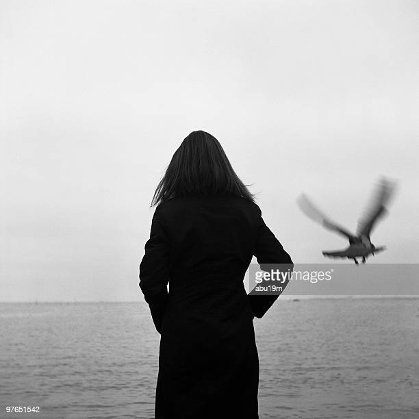 Woman looking at view of pigeon lake
