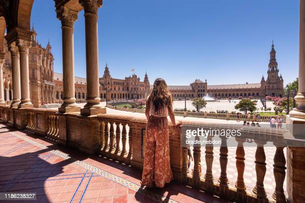 woman looking at view of plaza de españa in seville, spain - seville stock pictures, royalty-free photos & images